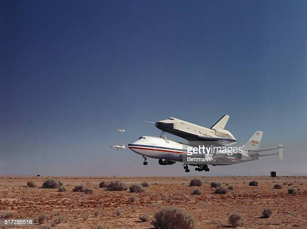 Edwards AFB California the space shuttle orbiter Enterprise riding piggy back on its 747 mother ship takes off from this test facility 6/18 on its...