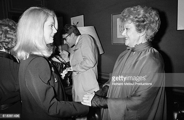 Edwige Feuillere greets fellow actress Catherine Deneuve on the opening night of Dear Liar which featured Feuillere The play going under the title of...