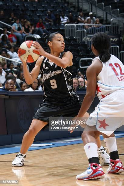 Edwige Lawson of the San Antonio Silver Stars looks to pass the ball against Ivory Latta of the Atlanta Dream during the WNBA game on June 18 2008 at...