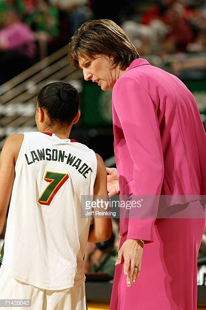 Edwige LawsonWade and Head coach Anne Donovan of the Seattle Storm talk on the sidelines during a game against the San Antonio Silver Stars on June...