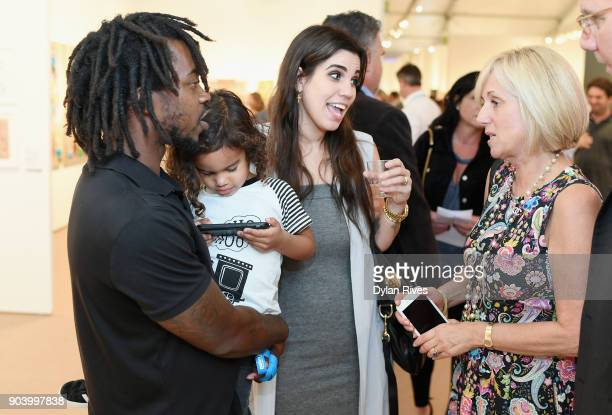 Edwin Baker and Olivia Namath attend the Palm Beach Modern Contemporary VIP Opening Preview Presented By Art Miami on January 11 2018 in West Palm...