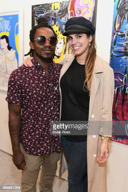 Edwin Baker III and Olivia Namath attend the Art Miami CONTEXT 2017 at Art Miami Pavilion on December 5 2017 in Miami Florida