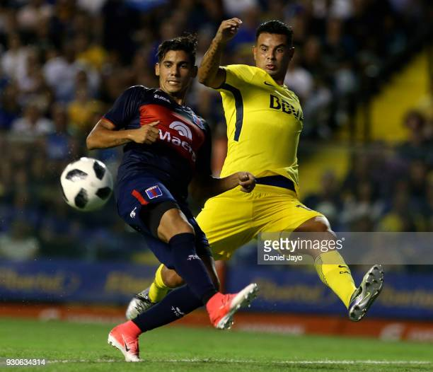 Edwin Cardona of Boca Juniors and Alexis Niz of Tigre fight for the ball during a match between Boca Juniors and Tigre as part of the Superliga...