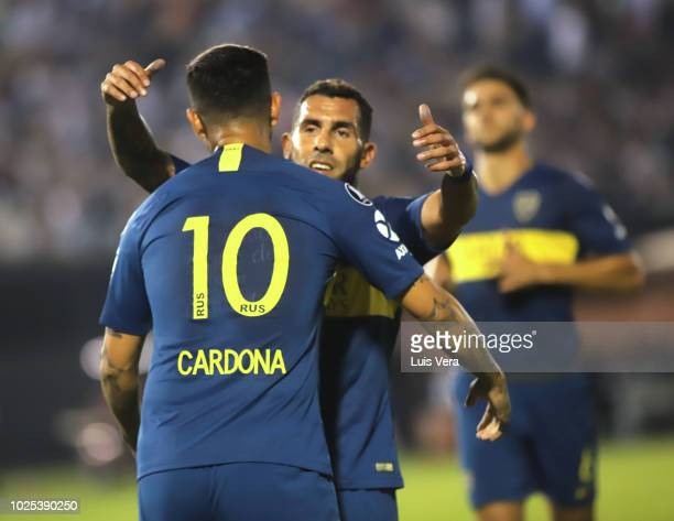 Edwin Cardona of Boca Juniors celebrates after scoring the fourth goal of his team via penalty with teammate Carlos Tevez during a round of sixteen...