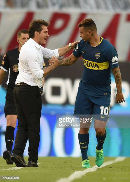 Edwin Cardona of Boca Juniors celebrates with his coach Guillermo Barros Schelotto after scoring the first goal of his team during a match between...