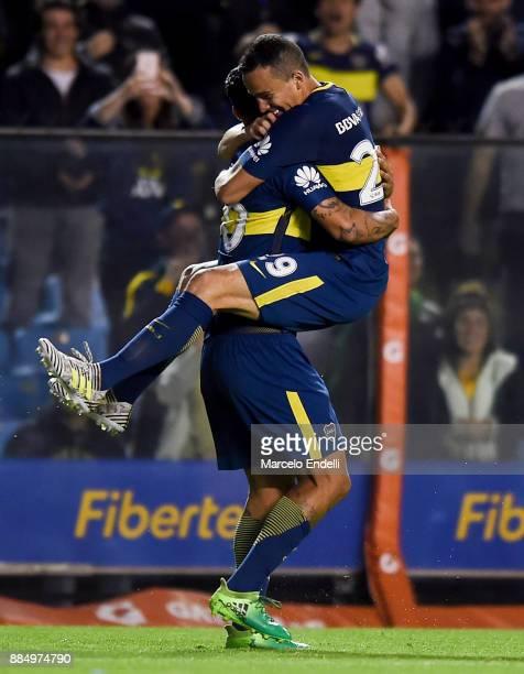 Edwin Cardona of Boca Juniors celebrates with his teammate Leonardo Jara after scoring the second goal of his team during a match between Boca...