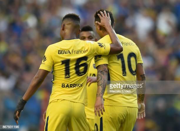 Edwin Cardona of Boca Juniors celebrates with teammate Wilmar Barrios after scoring the second goal of his team during a match between Boca Juniors...
