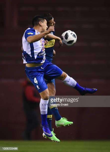 Edwin Cardona of Boca Juniors fights for the ball with Emanuel Urquiza of Alvarado during a match between Boca Juniors and Alvarado as part of Round...