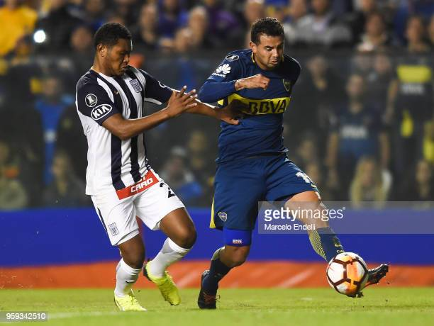 Edwin Cardona of Boca Juniors fights for the ball with Jose Cotrina of Alianza Lima during a match between Boca Juniors and Alianza Lima at Alberto J...