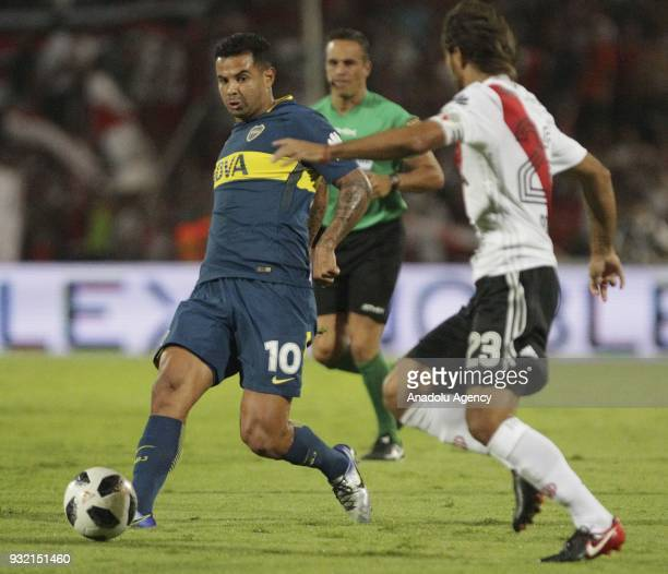 Edwin Cardona of Boca Juniors fights for the ball with Leonardo Ponzio of River Plate during the final match of the Argentine Supercup at the...