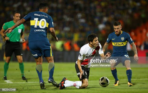 Edwin Cardona of Boca Juniors fouls Ignacio Fernandez of River Plate and commits a penalty during the Supercopa Argentina 2018 between River Plate...