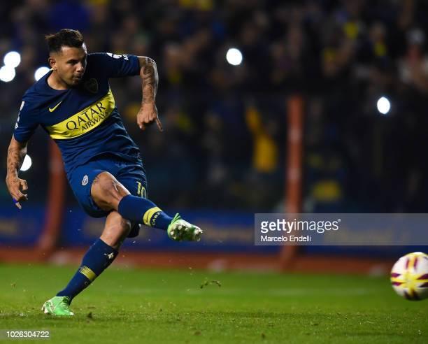Edwin Cardona of Boca Juniors kicks the ball to scores the penalty during a match between Boca Juniors and Velez as part of Superliga Argentina...