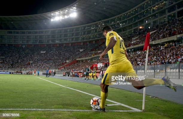 Edwin Cardona of Boca Juniors takes a corner kick during a groups stage match between Alianza Lima and Boca Juniors as part of Copa Conmebol...