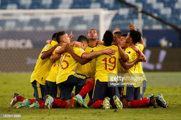 Edwin Cardona of Colombia celebrates with teammates after scoring the first goal of his team during a Group B match between Ecuador and Colombia at...