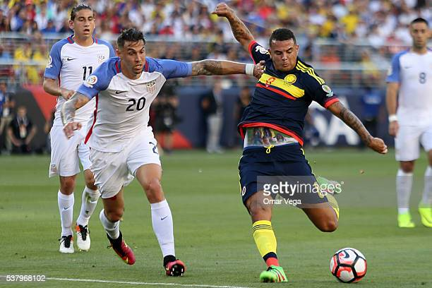 Edwin Cardona of Colombia fights for the ball with Geoff Cameron of United States during a group A match between United States and Colombia at Levi's...
