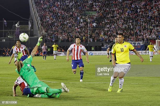 Edwin Cardona of Colombia shoots to score the opening goal during a match between Paraguay and Colombia as part of FIFA 2018 World Cup Qualifiers at...