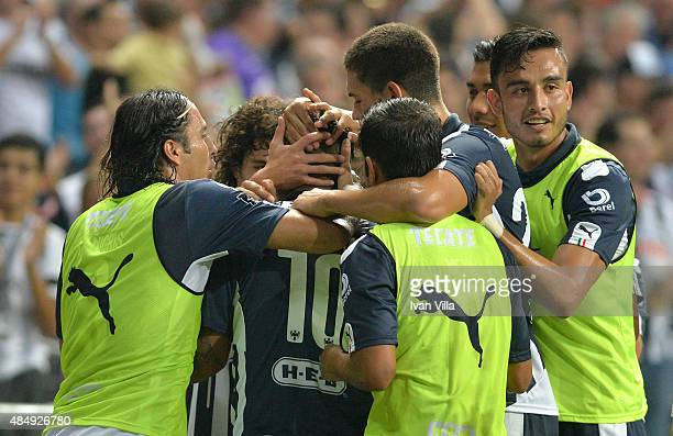 Edwin Cardona of Monterrey celebrates with teammates after scoring the opening goal during a 6th round match between Monterrey and Santos Laguna as...