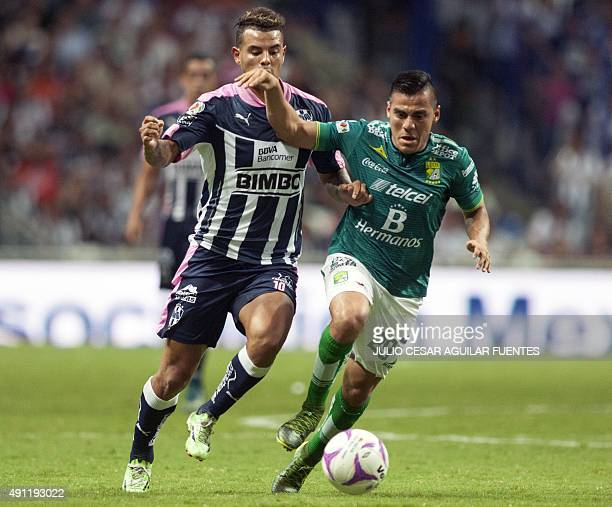 Edwin Cardona of Monterrey vies for the ball with Aldo Rocha of Leon during the Mexican Apertura 2015 tournament football match in Monterrey Mexico...