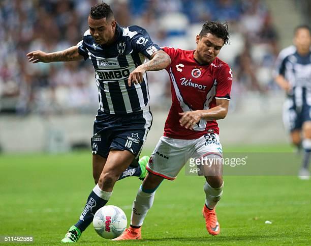 Edwin Cardona of Monterrey vies for the ball with Jesus Paganoni of Veracruz during the Mexican Clausura 2016 tournament football match at the BBVA...