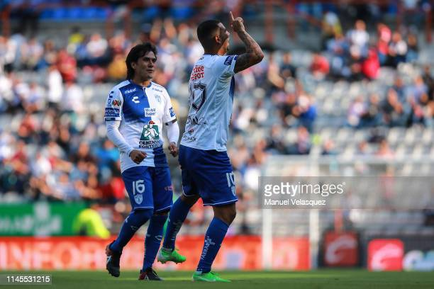 Edwin Cardona of Pachuca celebrates the first scored goal with Jorge Hernandez of Pachuca during the 16th round match between Pachuca and Atlas as...