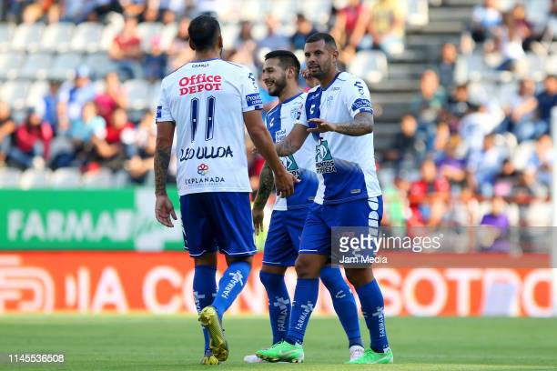 Edwin Cardona of Pachuca celebrates with teammates Leonardo Ulloa and Victor Sosa before scoring the first goal during the 16th round match between...