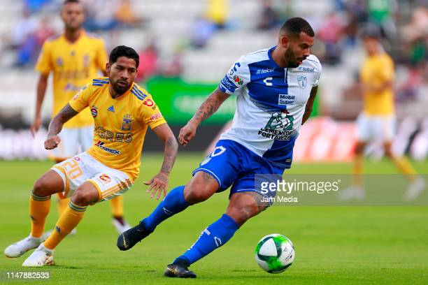 Edwin Cardona of Pachuca controls the ball against Javier Aquino of Tigres during the quarterfinals first leg match between Pachuca and Tigres UANL...