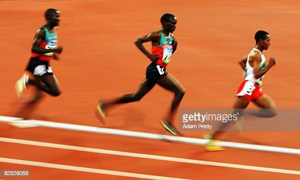 Edwin Cheruiyot Soi of Kenya Eliud Kipchoge of Kenya and Kenenisa Bekele of Ethiopia compete in the Men's 5000m Final held at the National Stadium on...