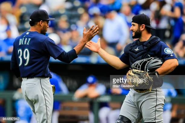 Edwin Diaz and David Freitas of the Seattle Mariners celebrate the win over the Kansas City Royals after the game at Kauffman Stadium on April 11,...