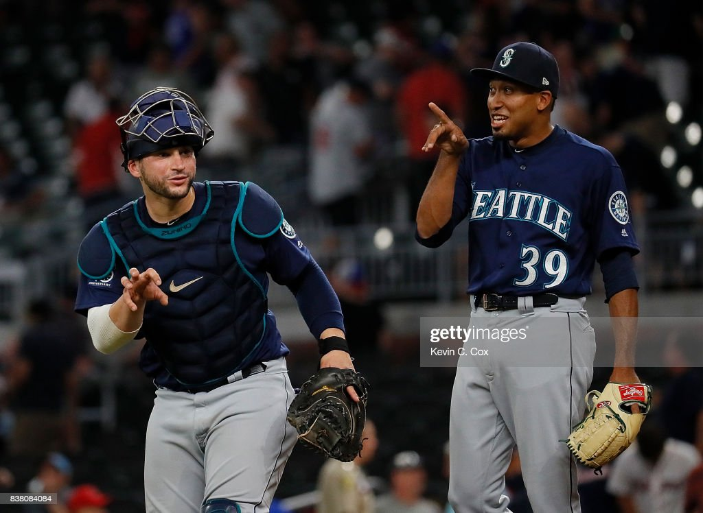 Edwin Diaz #39 and Mike Zunino #3 of the Seattle Mariners react after their 9-6 win over the Atlanta Braves at SunTrust Park on August 23, 2017 in Atlanta, Georgia.