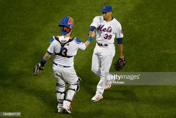 Edwin Diaz and Tomas Nido of the New York Mets celebrate after defeating the Miami Marlins at Citi Field on September 28, 2021 in New York City.