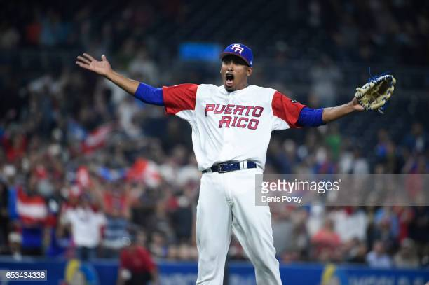 Edwin Diaz of Puerto Rico celebrates after Puerto Rico beat the Dominican Republic 31 in the World Baseball Classic Pool F Game One at PETCO Park on...