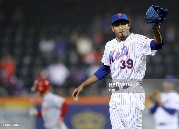 Edwin Diaz of the New York Mets reacts as Jose Iglesias of the Cincinnati Reds rounds the bases in the ninth inning after a solo home run at Citi...