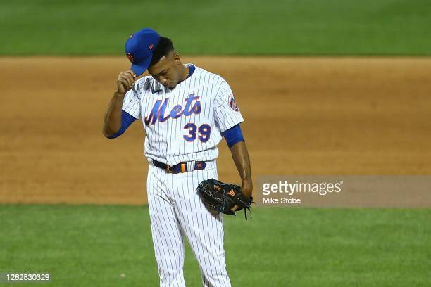Edwin Diaz of the New York Mets reacts during the \ninth inning against the Boston Red Sox at Citi Field on July 30, 2020 in New York City.