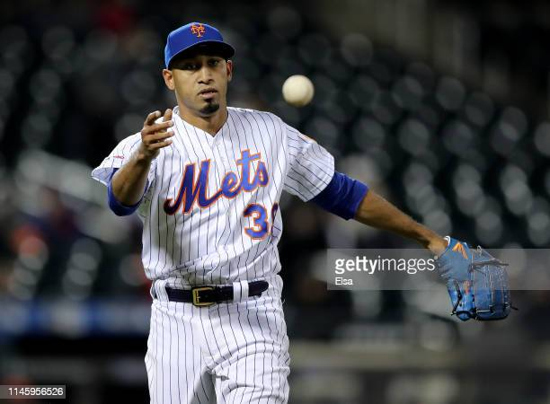Edwin Diaz of the New York Mets sends the ball to first base for the out to end the ninth inning against the Cincinnati Reds at Citi Field on April...
