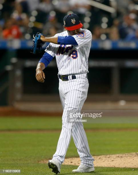 Edwin Diaz of the New York Mets walks to the dugout after he was removed from a game against the Philadelphia Phillies in the ninth inning at Citi...