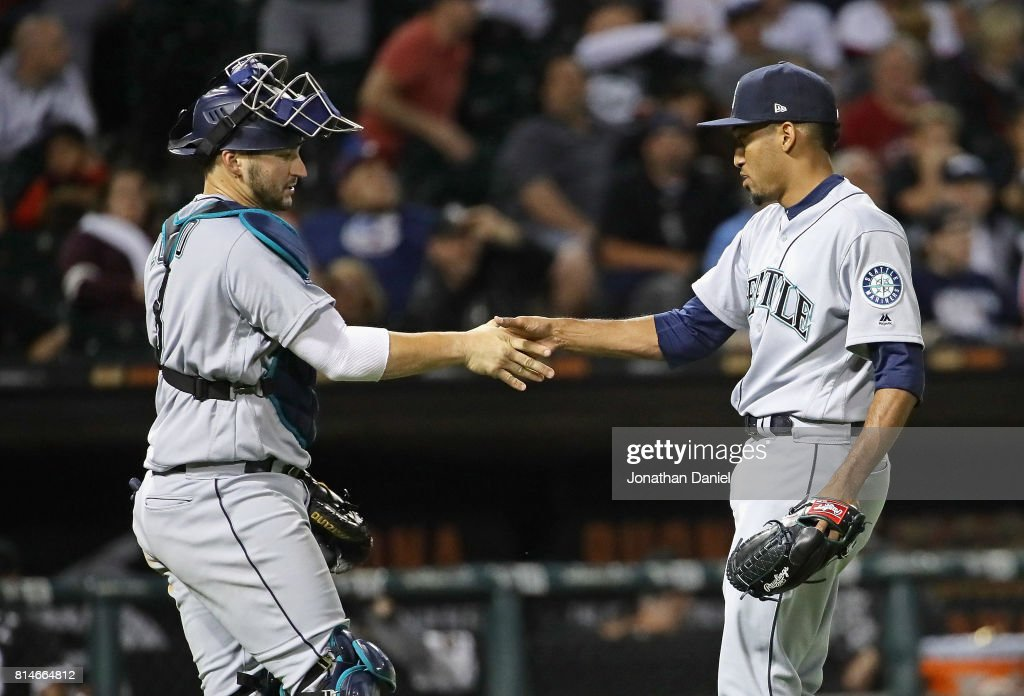 Edwin Diaz #39 of the Seattle Mariners (R) shakes hands with Mike Zunino #3 after a win against the Chicago White Sox at Guaranteed Rate Field on July 14, 2017 in Chicago, Illinois. The Mariners defeated the White Sox 4-2.