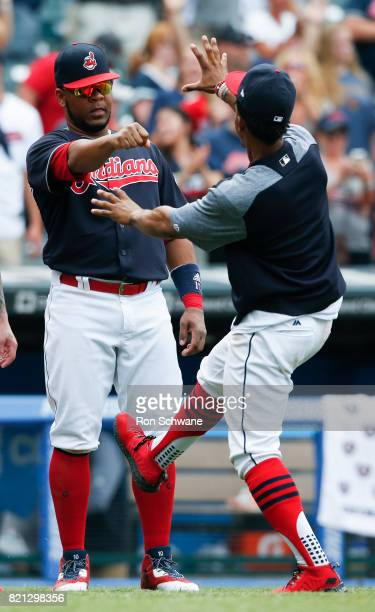 Edwin Encarnacion and Francisco Lindor of the Cleveland Indians celebrate an 81 victory over the Toronto Blue Jays at Progressive Field on July 23...
