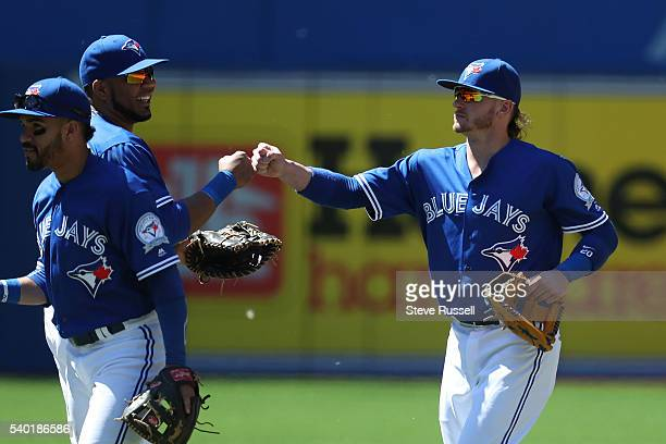 TORONTO ON JUNE 14 Edwin Encarnacion and Josh Donaldson fist bump as the Toronto Blue Jays win an afternoon game against the Philadelphia Phillies in...