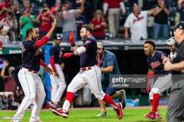 Edwin Encarnacion celebrates with Jason Kipnis of the Cleveland Indians after Kipnis hit a walkoff grand slam during the ninth inning against the...
