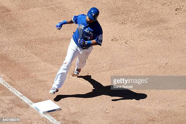 TORONTO ON JUNE 14 Edwin Encarnacion homers in the seventh inning as the Toronto Blue Jays play an afternoon game against the Philadelphia Phillies...