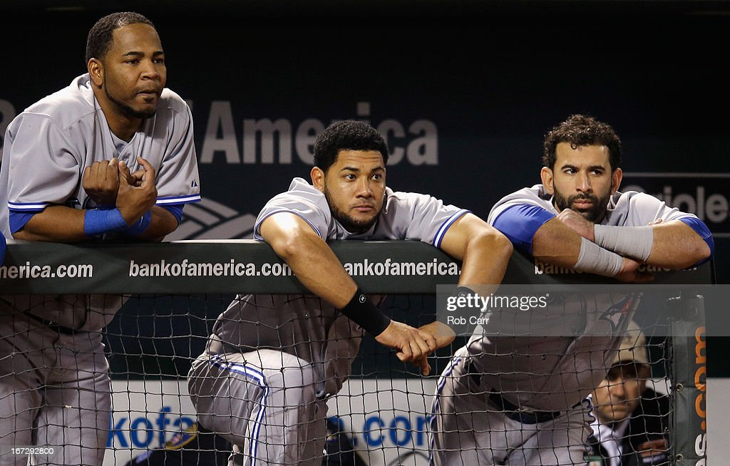 Edwin Encarnacion #10 (L), Melky Cabrera #53 (C), and Jose Bautista #19 of the Toronto Blue Jays look on from the dugout during the ninth inning of the Blue Jays 4-3 loss to the Baltimore Orioles at Oriole Park at Camden Yards on April 23, 2013 in Baltimore, Maryland.