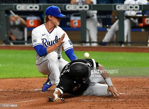 Edwin Encarnacion of the Chicago White Sox scores on a wild pitch by starting pitcher Brady Singer of the Kansas City Royals in the fifth inning at...