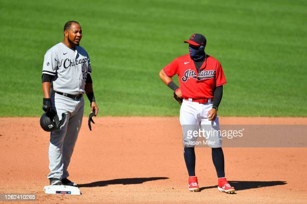 Edwin Encarnacion of the Chicago White Sox talks with second baseman Cesar Hernandez of the Cleveland Indians during the fourth inning of game 1 of a...