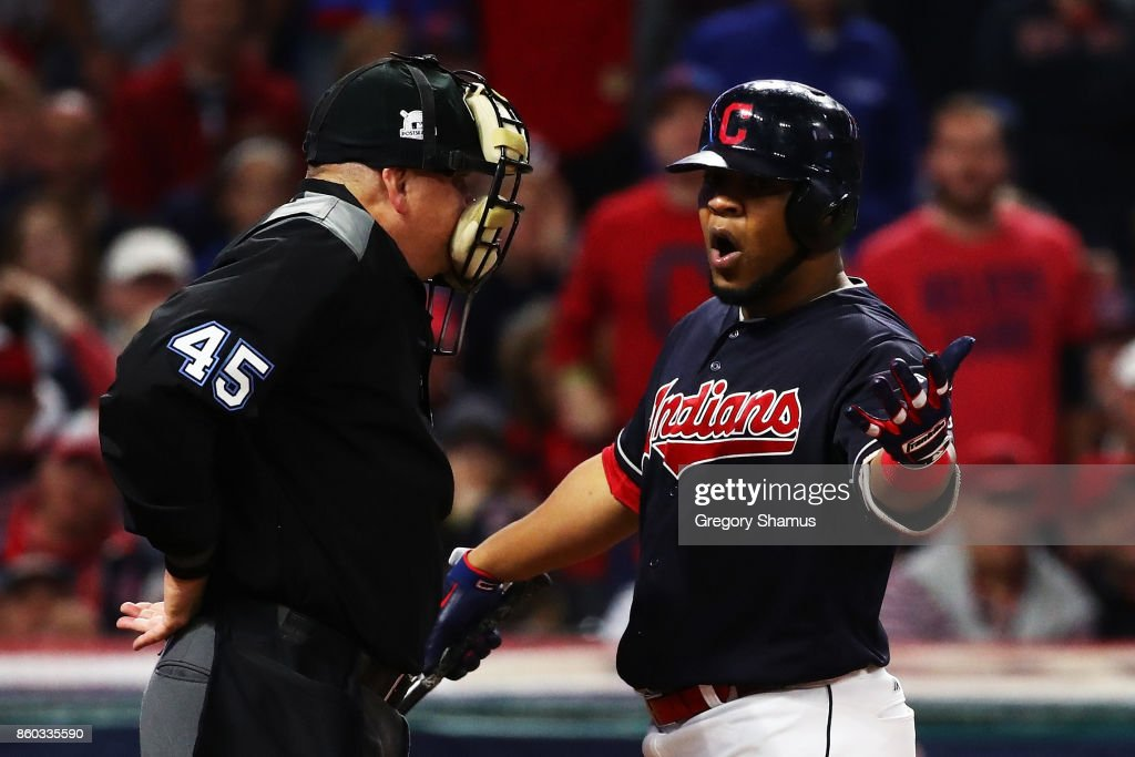 Edwin Encarnacion #10 of the Cleveland Indians agrues a third strike call by umpire Jeff Nelson in the fourth inning against the New York Yankees in Game Five of the American League Divisional Series at Progressive Field on October 11, 2017 in Cleveland, Ohio.
