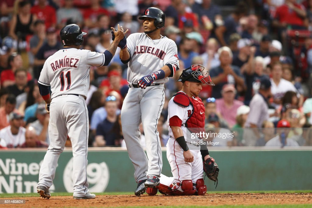 Edwin Encarnacion #10 of the Cleveland Indians celebrates with Jose Ramirez #11 after hitting a two run home run against the Boston Red Sox during the fifth inning at Fenway Park on August 14, 2017 in Boston, Massachusetts.