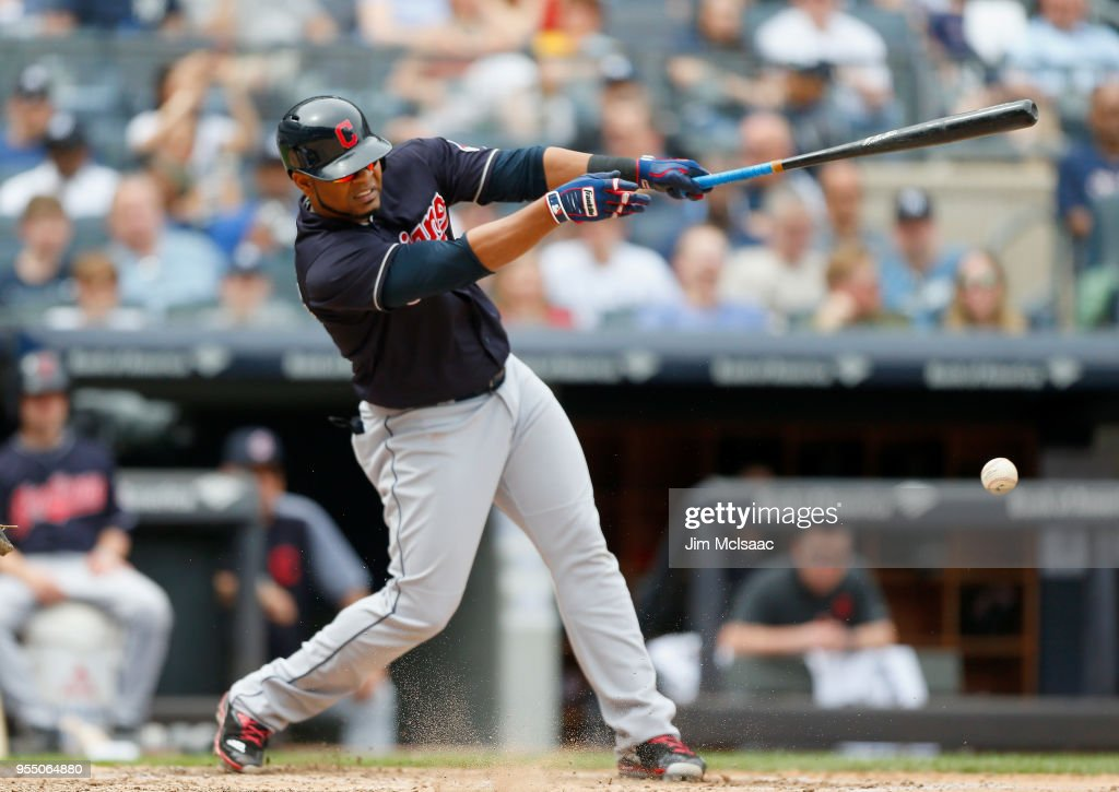 Edwin Encarnacion #10 of the Cleveland Indians connects on a sixth inning run scoring ground out against the New York Yankees at Yankee Stadium on May 5, 2018 in the Bronx borough of New York City.