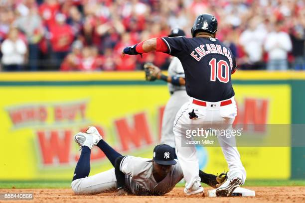 Edwin Encarnacion of the Cleveland Indians is injured in the first inning against the New York Yankees during game two of the American League...
