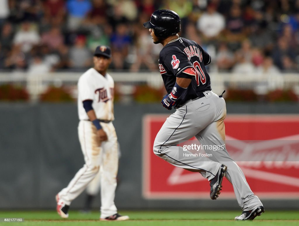 Edwin Encarnacion #10 of the Cleveland Indians rounds the bases after hitting a solo home run during the fifth inning of the game against the Minnesota Twins looks on as on August 15, 2017 at Target Field in Minneapolis, Minnesota.