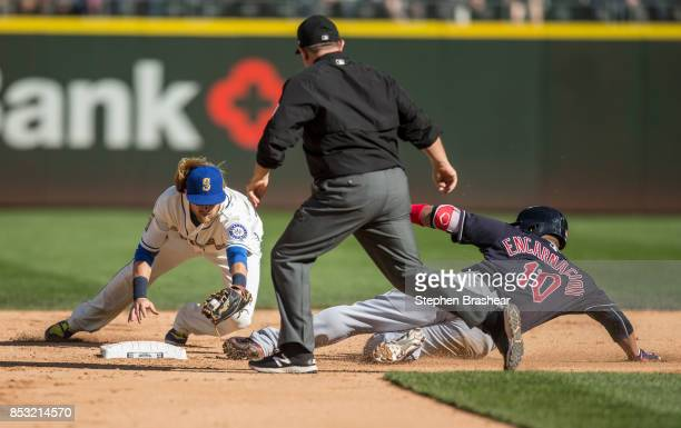 Edwin Encarnacion of the Cleveland Indians slides safely into first base for a double off of relief pitcher She Simmons of the Seattle Mariners ahead...