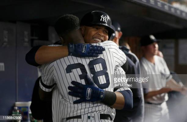 Edwin Encarnacion of the New York Yankees celebrates his eighth inning home run against the Tampa Bay Rays with teammate Cameron Maybin at Yankee...